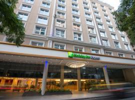 罗萨里奥快捷假日酒店,位于罗萨里奥的酒店
