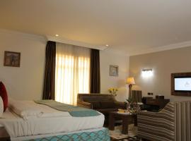 大培拉套房酒店,位于阿布贾的酒店