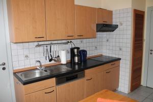 Ferienwohnungen im Gästehaus Sieberns的厨房或小厨房