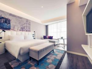 上海虹桥美仑美居酒店 客房内的一张或多张床位
