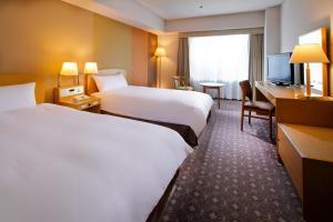 Miyako Hotel Kyoto Hachijo客房内的一张或多张床位
