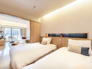 箱根芦香织日式旅馆客房内的一张或多张床位