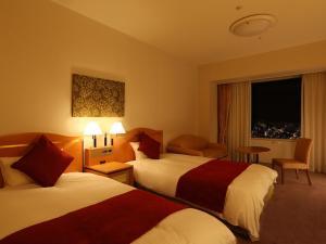 星际之门关西机场酒店客房内的一张或多张床位