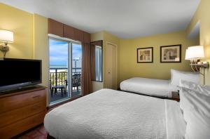 美特尔海滩海湾景度假酒店客房内的一张或多张床位