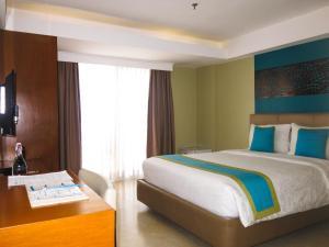 长滩岛天堂度假酒店客房内的一张或多张床位