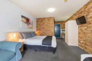 达博市康福特茵酒店客房内的一张或多张床位