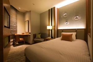 海兰德水疗度假酒店客房内的一张或多张床位