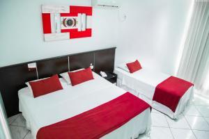 巴西利亚公园酒店客房内的一张或多张床位
