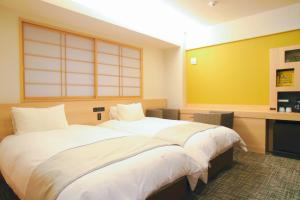 M's Est 四条乌丸酒店客房内的一张或多张床位