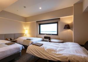 旭川JR酒店客房内的一张或多张床位