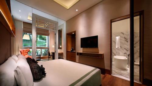 福康宁酒店客房内的一张或多张床位