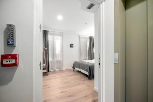 32 de Agosto rooms by SanSebastianForYou客房内的一张或多张床位
