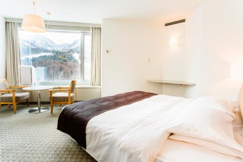 Shin Furano Prince Hotel客房内的一张或多张床位