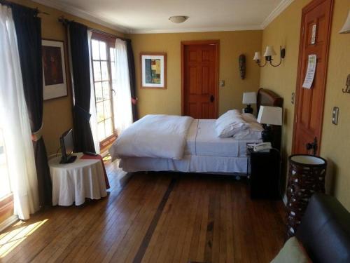 曼诺尔阿特金森酒店客房内的一张或多张床位
