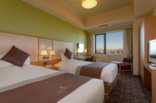 大阪蒙特利格拉斯米尔酒店客房内的一张或多张床位
