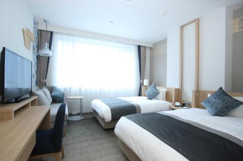 祝之宿登别格阑饭店客房内的一张或多张床位