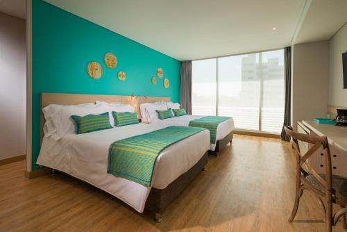 BH巴兰基亚酒店客房内的一张或多张床位