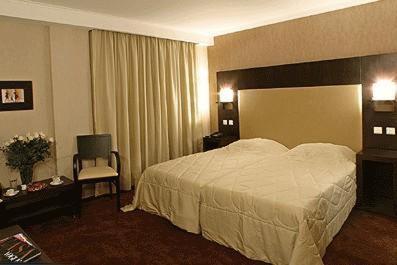 阿拉希亚酒店客房内的一张或多张床位