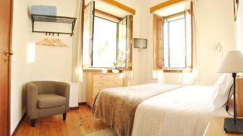 豪斯佩达利亚咖啡佩拉酒店客房内的一张或多张床位