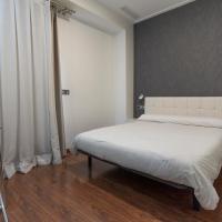 鲁纳酒店,位于阿尔齐拉的酒店